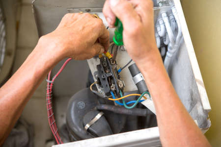 adjuster: Air Conditioning Technician install new air conditioner.