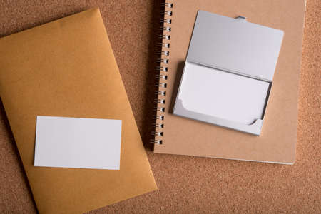 bussiness man: blank name card and blank envelope on wooden table