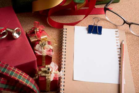 blank page paper and holiday decoration on wood table