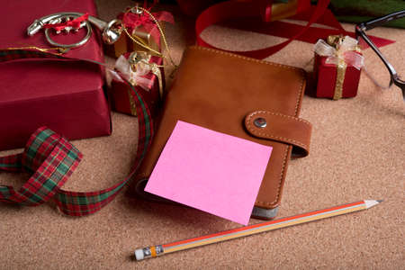 blank note paper and holiday decoration on wood table