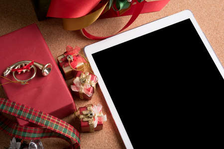 smart device and holiday decoration on wood table