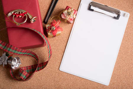 blank note pad with holiday decoration on wood table