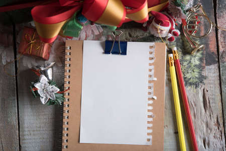 blank note book and holiday decoration on wood table