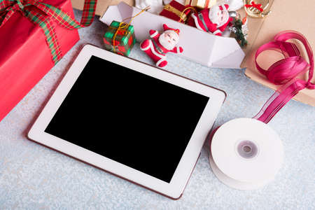 blank computer tablet and holiday decoration on wood table