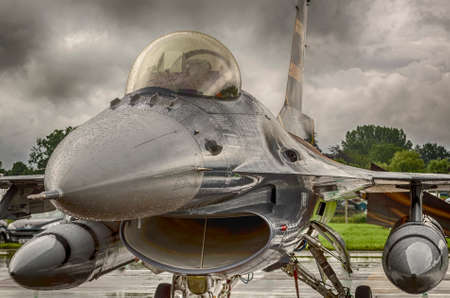 fighter jet: F16 Fighter jet shown against stormy skies and rain