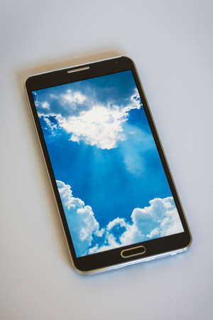 comtemporary: Isolated smartphone, showing cloud computing concept on screen Stock Photo