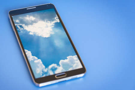 comtemporary: isolated smartphone, showing cloud computing concept on screen, blue background