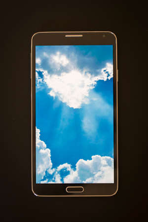 isolated smartphone, showing cloud computing concept on screen, black background photo