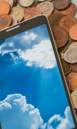 comtemporary: isolated smartphone, showing cloud computing concept on screen, cash background