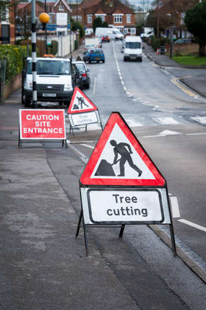 Tree cutting sign, on British town street photo