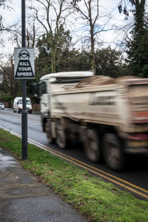 seemingly: Kill your speed sign, with lorry seemingly speeding past