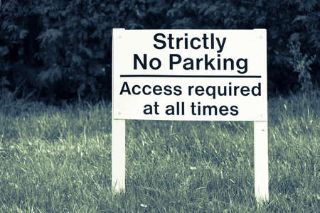 strictly: Strictly no parking sign, black on white. Stock Photo