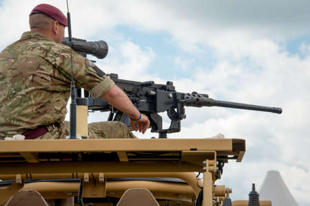 british army: Duxford, UK - 25th May 2014: British Army machine gunner at Duxford Airshow.