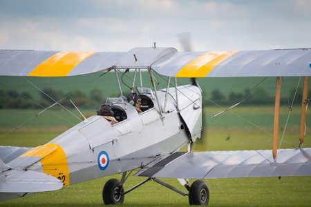 airshow: Duxford, UK - 25th May 2014: Vintage  Tiger moth used for pleasure flights by Classic Wings at Duxford Airshow.