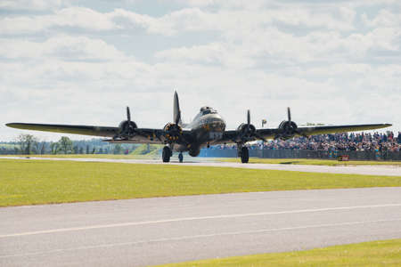 restored: Duxford, UK - 25th May 2014: B17 Flying Fortress Memphis Belle at Duxford Airshow.