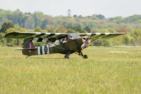 airshow: Abingdon UK - 4th May 2014: A restored vintage Piper Cub aircraft seen at Abingdon Airshow. Editorial