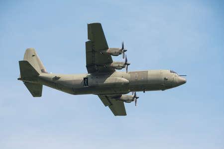 turboprop: Abingdon, UK - 4th May, 2014:  An RAF C130 Hercules transport aircraft in flight at Abingdon Airshow.