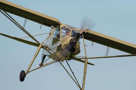 Abingdon, UK - May 4th, 2014: A vintage Fieseler Storch, German WW2 Reconnaissance aircraft, in flight at Abingdon Airshow.