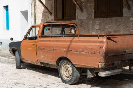 Rusty pick up truck, battered old automobile.