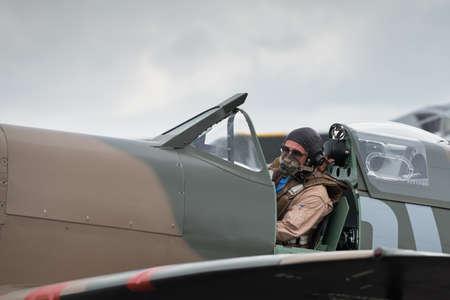 britan: Duxford, UK - 13 July 2014: Pilot in World War 2 vintage British Spitfire fighter plane at Duxford Flying Legends Airshow