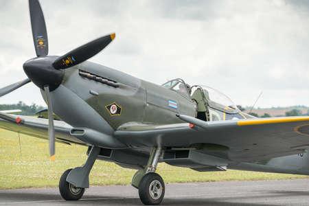 britan: Duxford, UK - 13 July 2014: World War 2 vintage British Spitfire fighter plane at Duxford Flying Legends Airshow