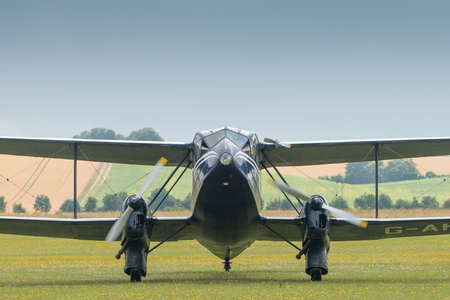 airshow: Duxford, UK - 13 July 2014:  Vintage British Dragon Rapide plane at Duxford Flying Legends Airshow Editorial