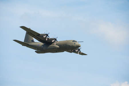 airshow: Duxford,UK - 25 May 2014: An RAF Hercules flying at  Duxford D-Day Airshow Editorial
