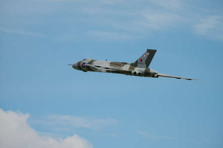 falklands war: Cosford, UK - 8 June 2014: Vintage British restored Vulcan Bomber XH558, displaying at the RAF Cosford Airshow.