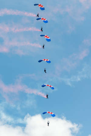 raf: Cosford, UK - 08 June 2014: RAF Falcon parachute display team seen at RAF Cosford Airshow.