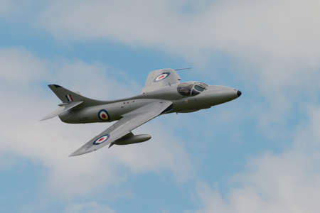 raf: Cosford, UK - 8 June 2014: MidAir Squadrons  Hawker Hunter T7, displaying at the RAF Cosford Airshow.