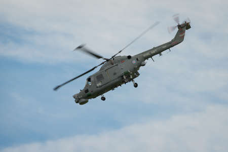 aerobatic: Cosford, UK - 8 June 2014: A Royal Navy Westland Lynx helicopter, displaying at the RAF Cosford Airshow.