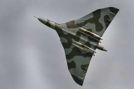 Cosford, UK - 8 June 2014: Vintage British restored Vulcan Bomber XH558, displaying at the RAF Cosford Airshow.