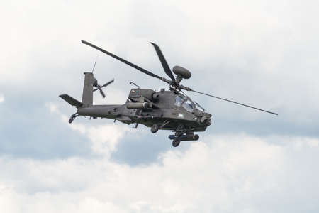 raf: Cosford, UK - 8 June 2014: A British Army Apache helicopter, displaying at the RAF Cosford Airshow.