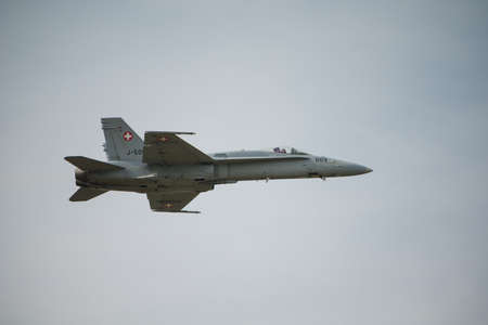 usn: Fairford, UK - 12 July 2014: Swiss Airforce F18 Hornet fighter aircraft in flight and displaying at the Royal International Air Tattoo. Editorial