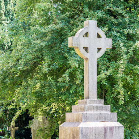 life after death: Stone cross marking an English grave