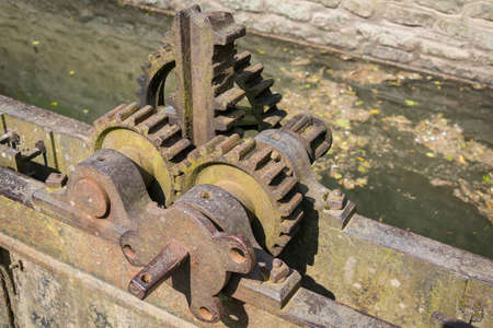 canal lock: Vintage iron gear wheels on canal lock gate in Ludlow, England.