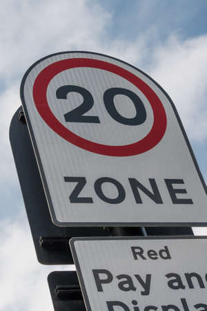 mph: 20 mph zone, road sign, seen in UK.