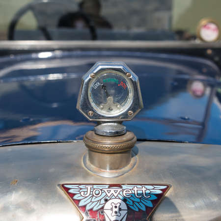 Biggleswade, UK - 29 June 2014: A vintage temperature guage on a Jowett Type C car (1926) on display at the Shuttleworth Collection air show.
