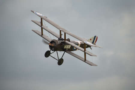 shuttleworth: Biggleswade, UK - 29 June 2014: A vintage 1916 British Sopwith Triplane on display at the Shuttleworth Collection air show. Editorial