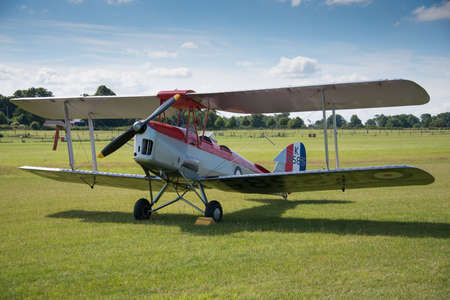Biggleswade, UK - 29 June 2014: A vintage DH82a Tiger Moth biplane on display at the Shuttleworth Collection museum.