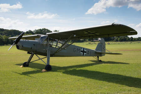monoplane: Biggleswade, UK - 29 June 2014: A vintage German Fieseler Storch aircraft at the Shuttleworth Collection air show.