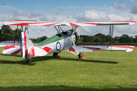 shuttleworth: Biggleswade, UK - 29 June 2014: A vintage Avro Tutor bi plane on display at the Shuttleworth Collection air show.