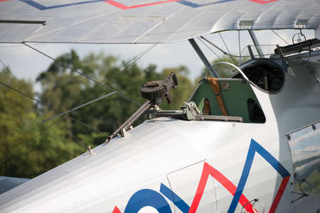Biggleswade, UK - 29 June 2014: A machine gun on a vintage  Hawker Demon bi-plane on display at the Shuttleworth Collection air show.
