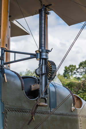 shuttleworth: Biggleswade, UK - 29 June 2014: A vintage machine gun on an RAF BE2c fighter plane on display at the Shuttleworth Collection air show. Editorial