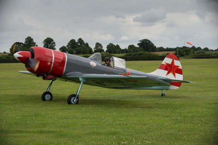 shuttleworth: Biggleswade, UK - 29 June 2014: A vintage  YAK 52 with pilot Mark Levy about to display at the Shuttleworth Collection air show.