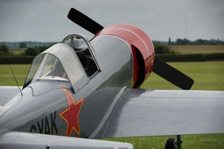 shuttleworth: Biggleswade, UK - 29 June 2014: A vintage  YAK 52 belonging to the Aerostars team at the Shuttleworth Collection air show. Editorial