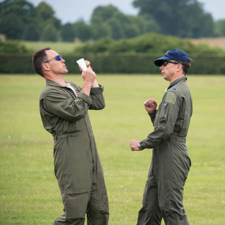 Biggleswade, UK - 29 June 2014: Pilots Mark Rijkse and Phil Ansell perform a ground walk through of their display for the Aerostars team at the Shuttleworth Collection air show. Editorial