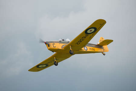 Biggleswade, UK - 29 June 2014: A vintage Miles Magister M.14 training aircraft on display at the Shuttleworth Collection museum.