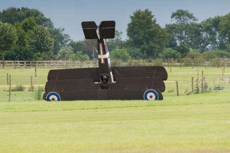 shuttleworth: Biggleswade, UK - 29 June 2014: A vintage 1916 British Sopwith Triplane crash landed at the Shuttleworth Collection air show.