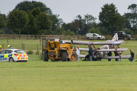 landed: Biggleswade, UK - 29 June 2014: A vintage 1916 British Sopwith Triplane crash landed at the Shuttleworth Collection air show.